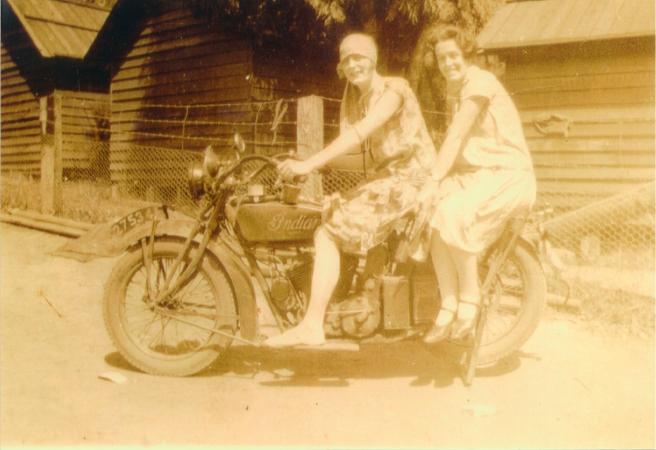 Vera posing on a motor bike her friend Jessie behind